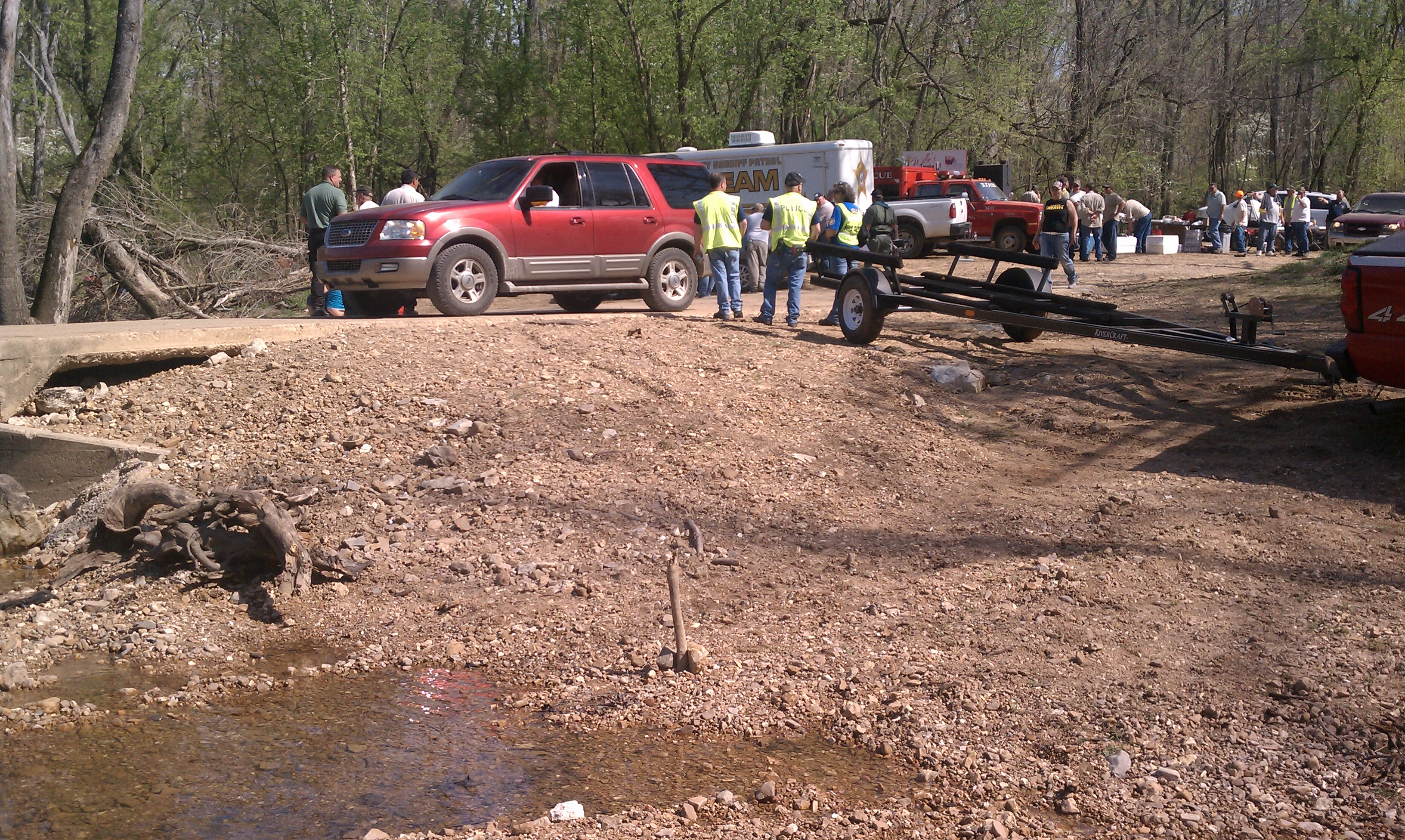 Volunteers and officials help with the search for Caleb