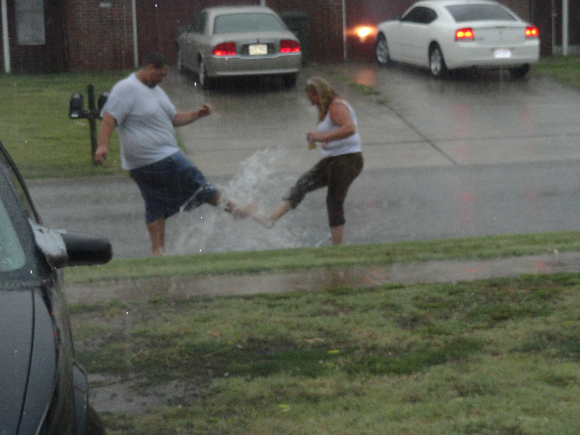 adults playing in the rain