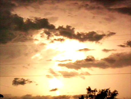 Lightning from storms south of Hartman on 9/7/12 turned the night sky to gold.