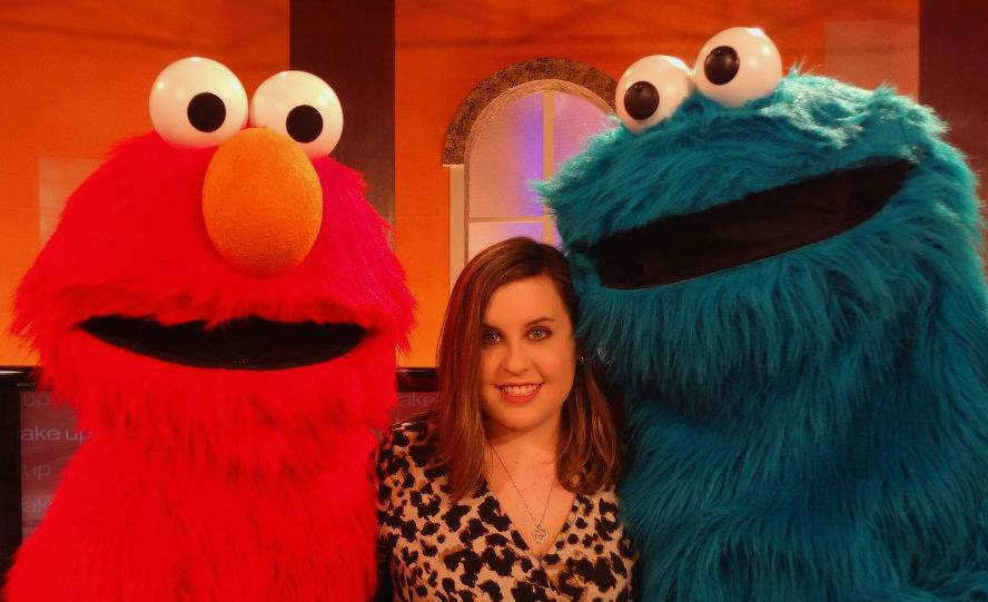 Elmo, Cookie Monster and assistant producer Meagan