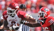Joe Adams headed up a trio of Razorbacks selected on the final day of the NFL draft.