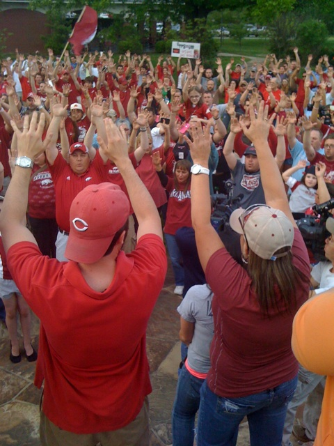 Petrino fans call the hogs at rally.
