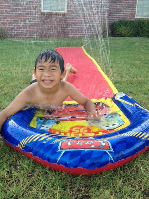 Drew and the water slide - Jessica Flores-Jaymalin