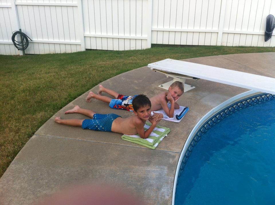 Hayden & Ayden laying out by the pool - Ashley Garris