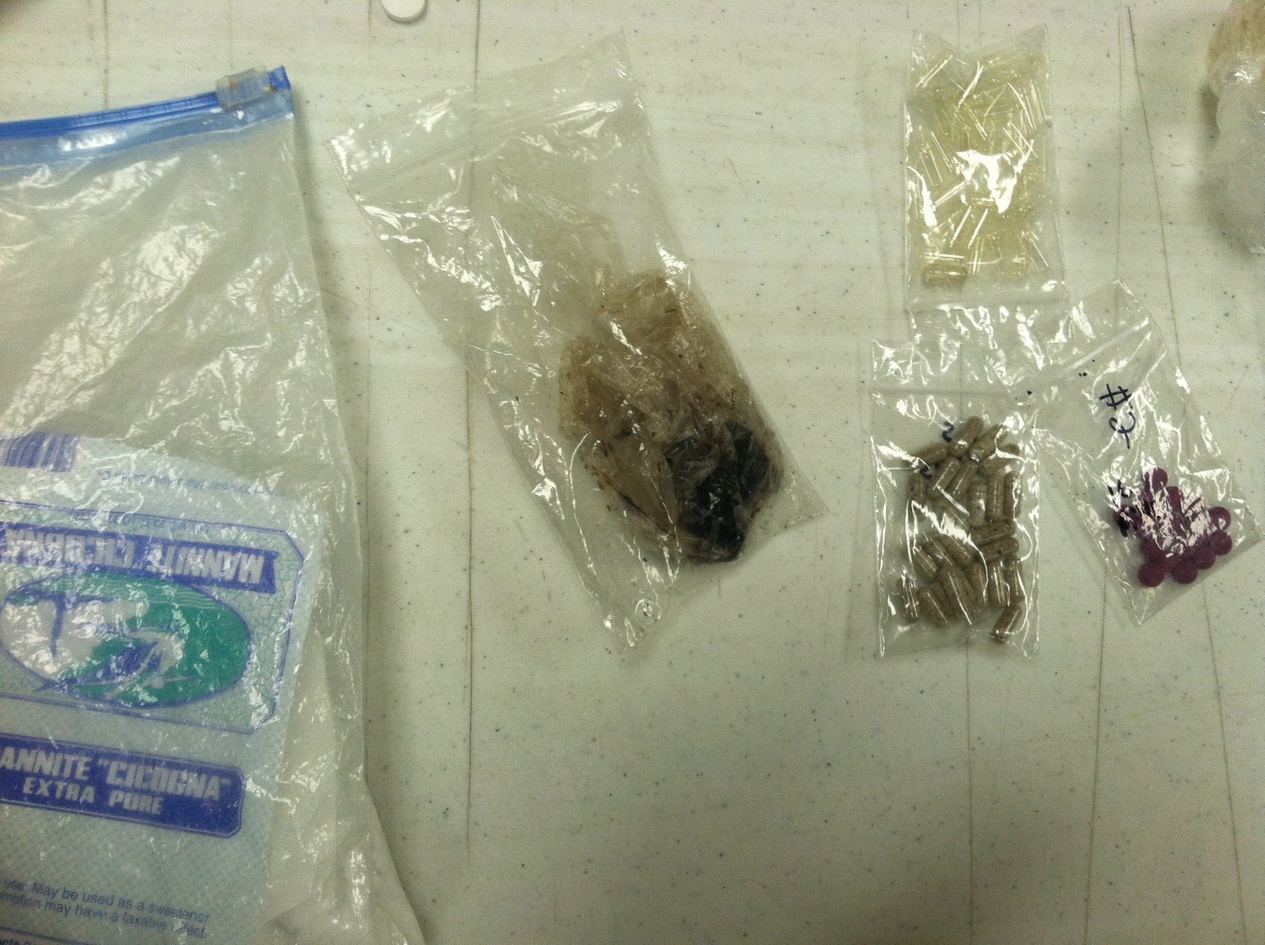 Black tar heroin and other items seized during drug bust