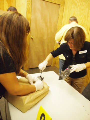 The Citizen's Academy learns about crime scene investigation with Sgt. Janell Daggett