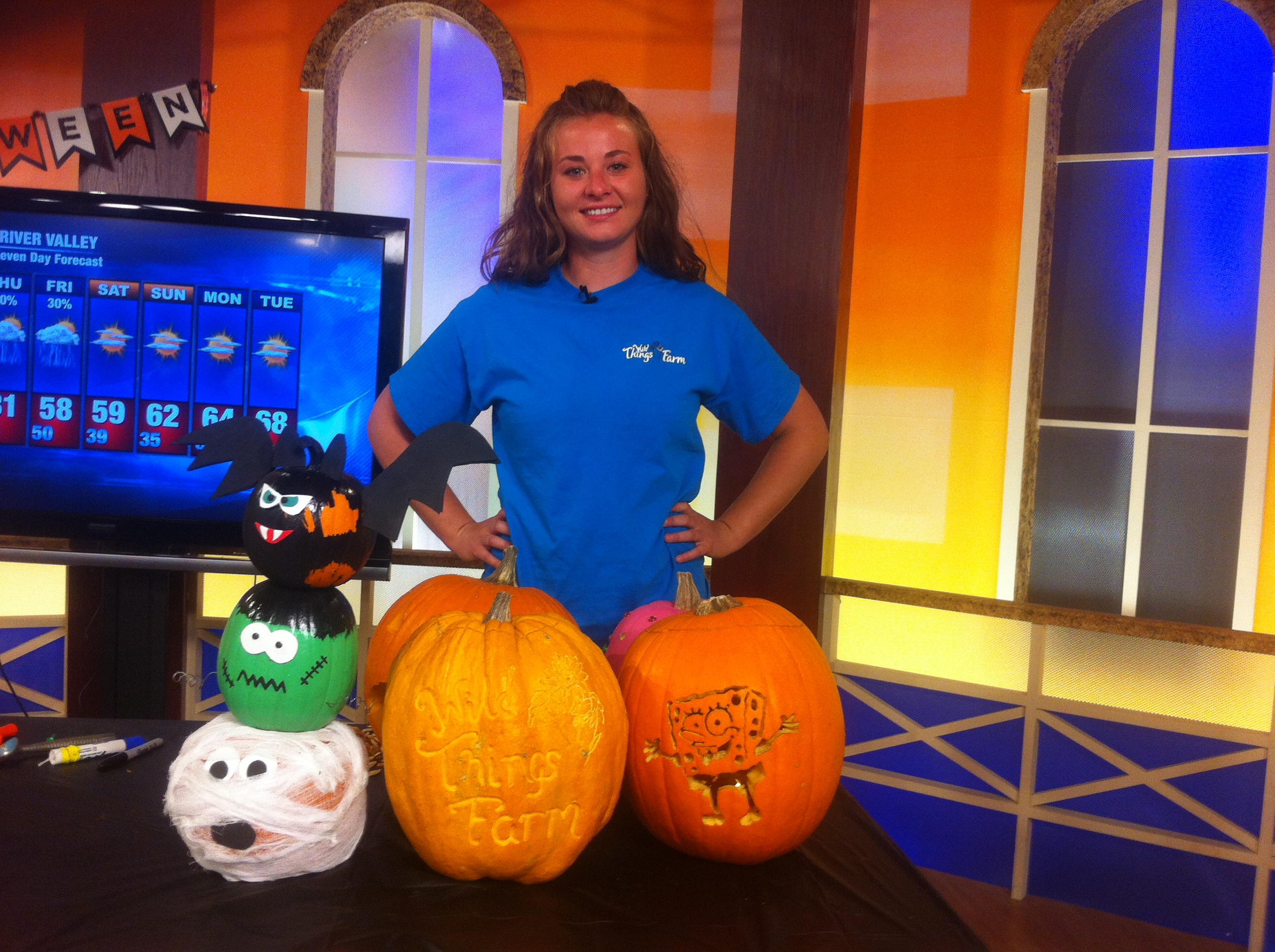 Christy Neu with Wild Things Farm in Pocola shows off her pumpkins.