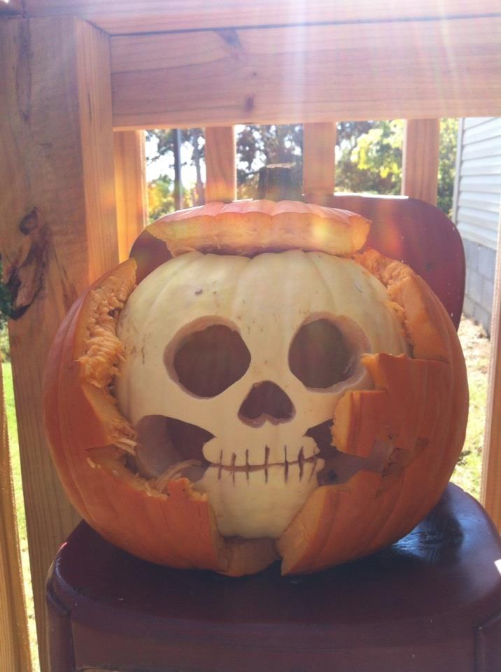 My son Jared Henson bought a white pumpkin and an orange pumpkin, then carved both into this. It turned out way cool!