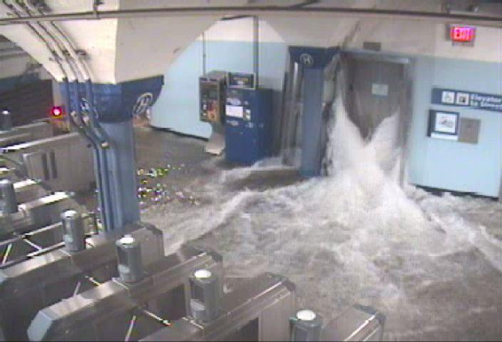 Flood Waters rush into the Hoboken PATH station