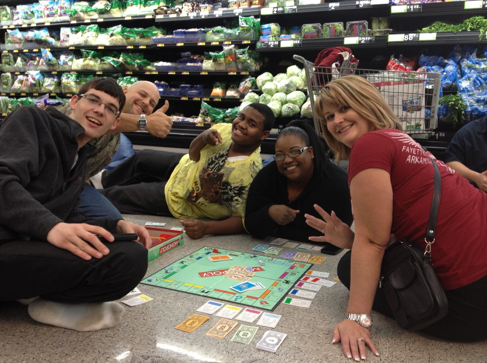 A Group Waiting for TVs at Van Buren Passes Time by Playing Monopoly. Courtesy: Leanne Donelson