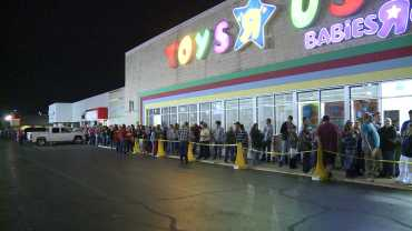 Hundreds Wait in Line at Walmart in Toys R Us