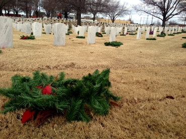 christmas honor wreaths blown over
