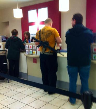 Man with rifle shopping at Riverdale JCPenney. (from Cindy Yorgason, Facebook)