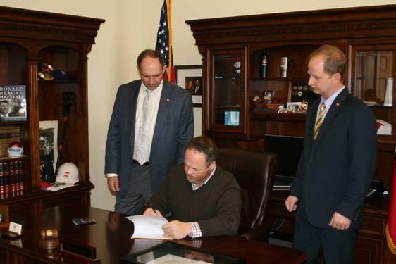 Senator Bruce Holland, Governor Mark A. Darr and Representative Andy Davis