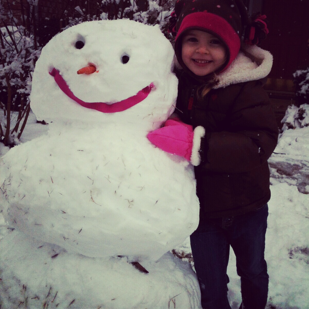 Mia and her Snowman in Fort Smith