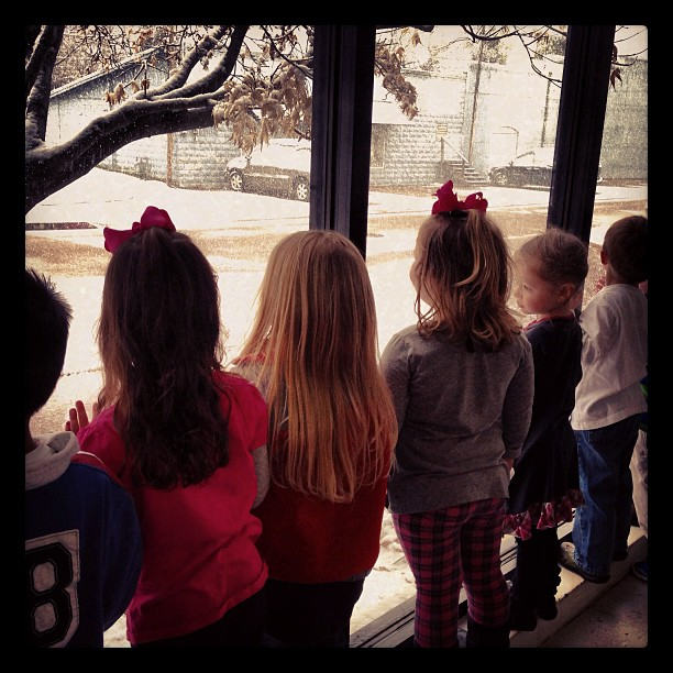 Some children at First Place Academy were a little excited that it was snowing....if only they had recess outside!