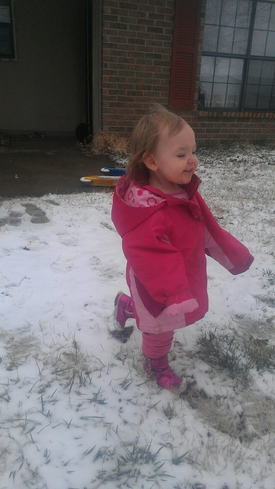 This is the first time she's ever been in the snow~19 mos old She loved running around in it and threw a fit when it was time to come in! haha