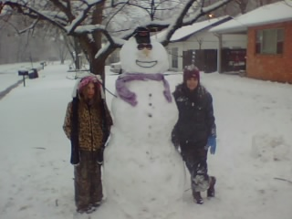my neighbor made this snowman, it was cool, he didnt have the usual stuff so the snowman has a arkansas hat, sunglasses, a gas can nozzle for a nose and pipe cleaners for a mouth, thought he was just fine for a snowman from arkansas.