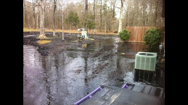 Backyard in Mayflower flooded in oil. (Photo: Christopher Mullins, THV 11 Viewer)
