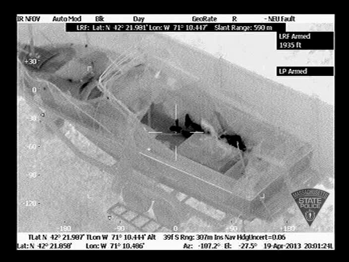 Massachusetts State Police release images of Boston Marathon bombing suspect Dzhokar Tsarnaev hiding in the boat in a backyard of Watertown on April 19, 2013.