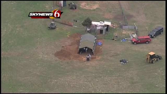 Authorities digging in a field near Jennings in mid-April. (KOTV)