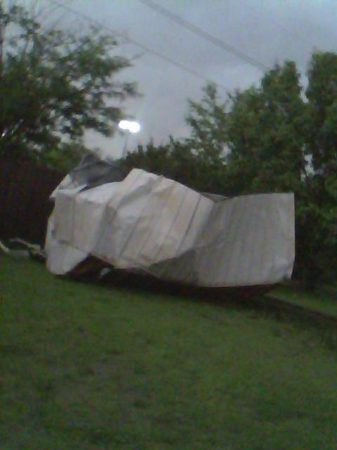 the flying shed from two houses down that took fences and a swing set out