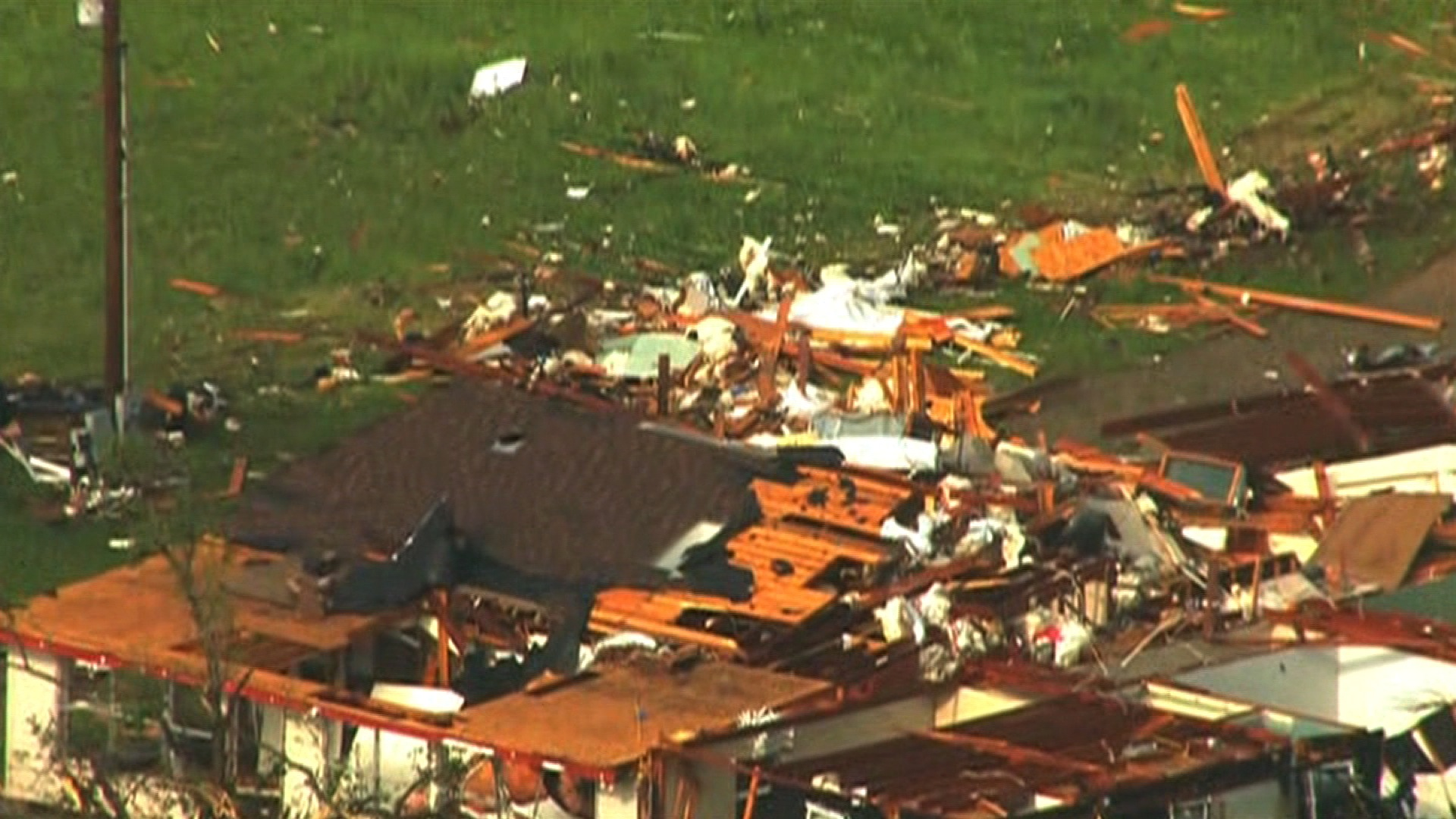 Tornadoes strike several states, devouring homes and killing 1 man
