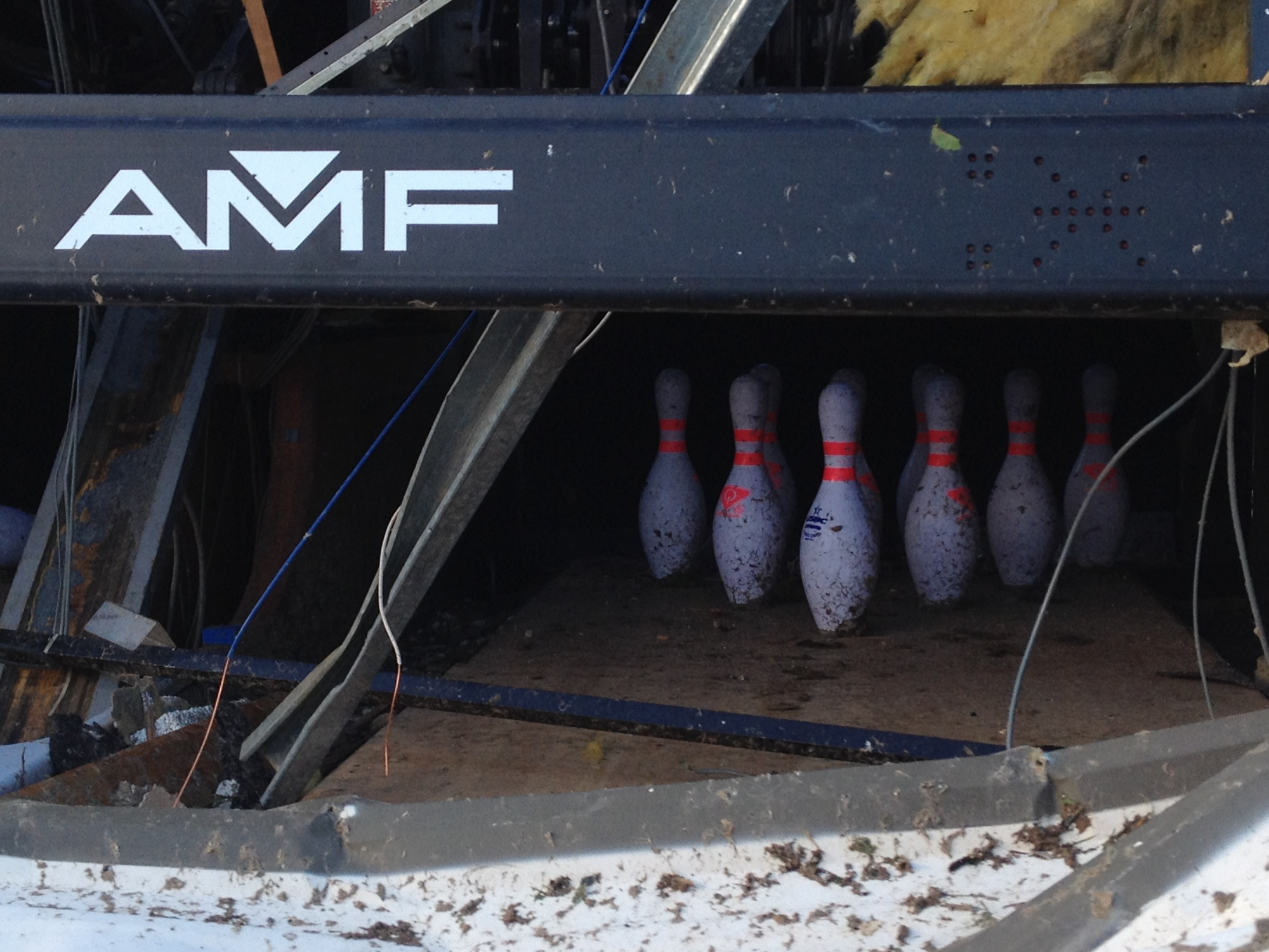 All 10 bowling pins in Lane 40 of the bowling alley in Moore, Oklahoma across the street from the damaged medical center and the damaged Warren movie theater.