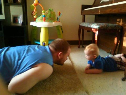 Jacob loves when his daddy plays with him.