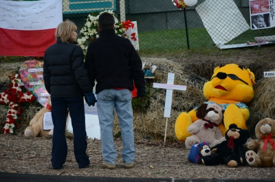 Crosses are left at the impromptu memorial in Newtown