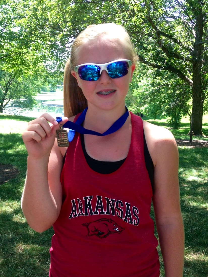 McCorkle with her AR Junior Olympic Medal