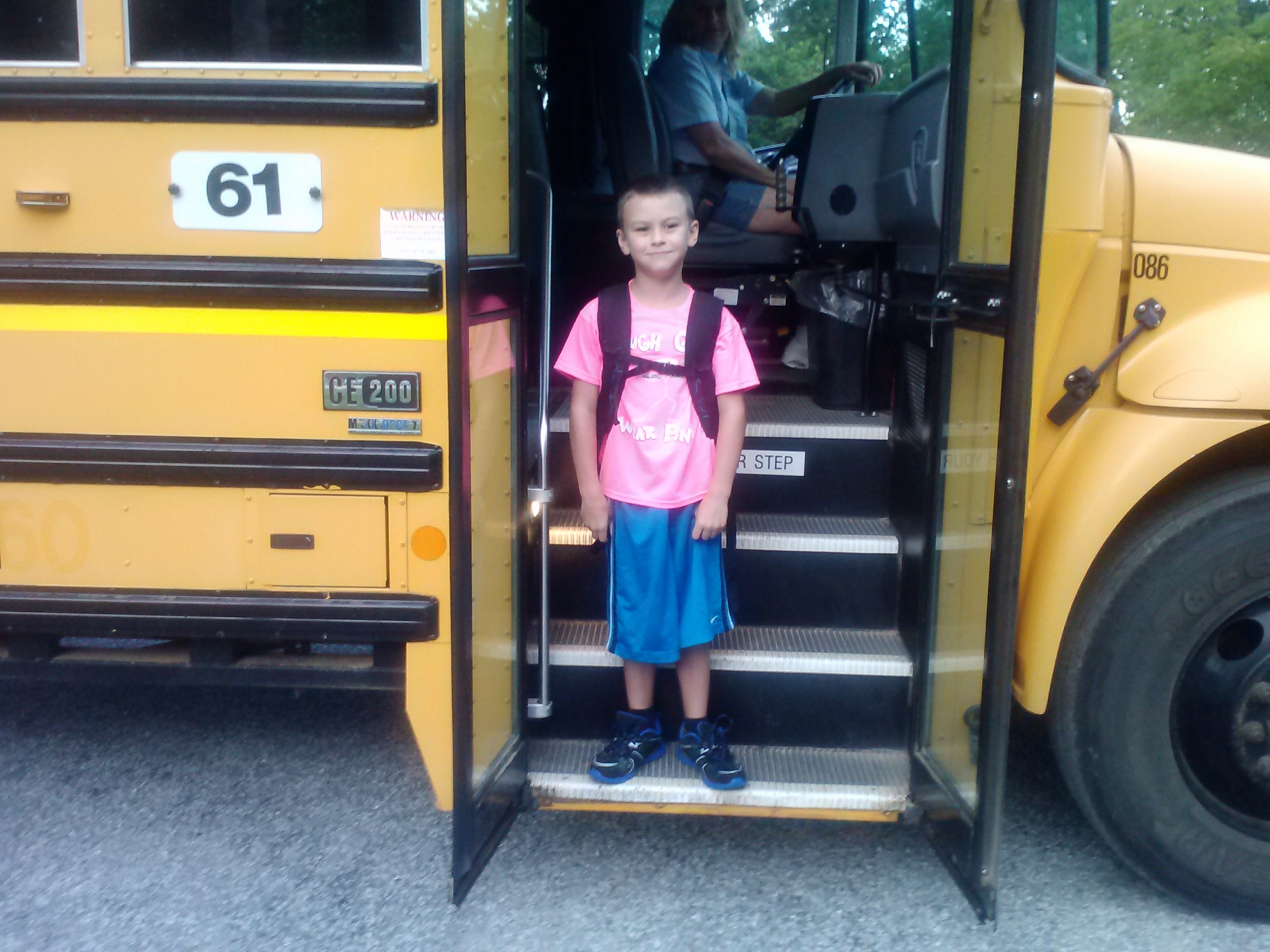 "Reaven Caillouet, 7 years old. First day at Jones Elementary in Rogers, second grade. He picked out a pink shirt saying ""Tough Guys Wear Pink"", and was so excited to go back to his teachers and friends. We live near Horseshoe bend area on Beaver Lake."