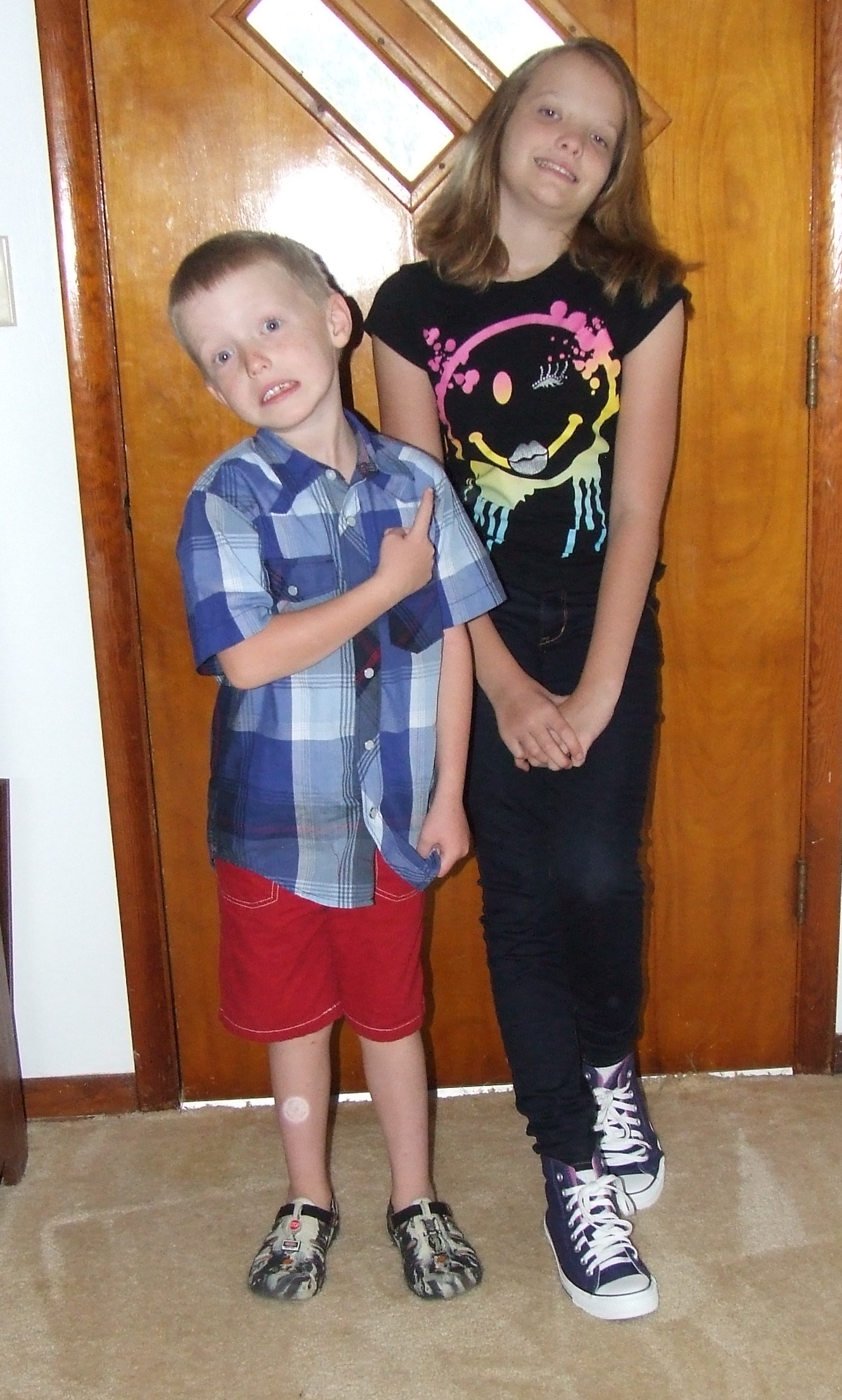 Mia was thrilled to be starting the 7th grade. Zac was not so excited about the 1st grade :)