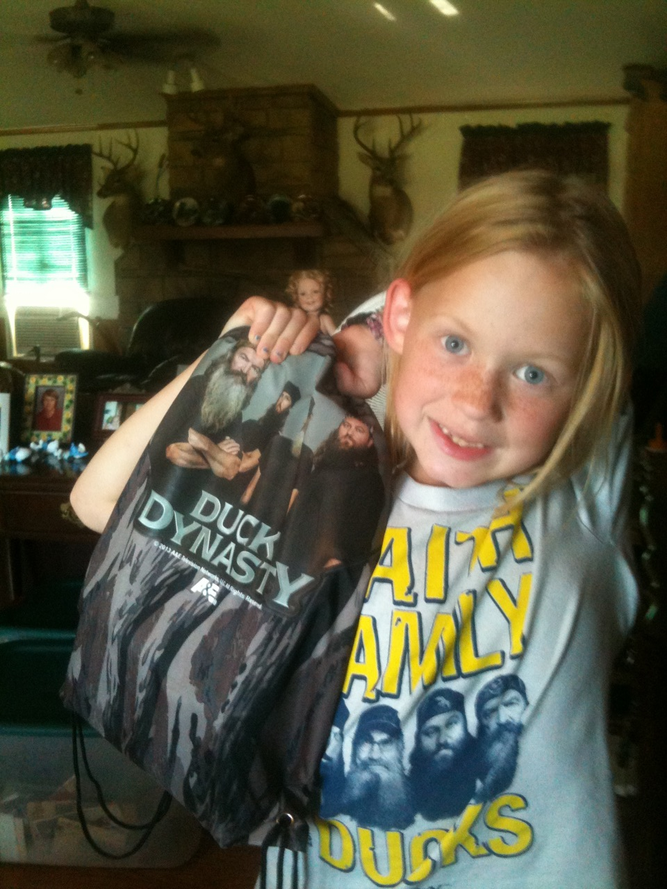 Faith is proud of her new Duck Dynasty T-shirt and backpack.