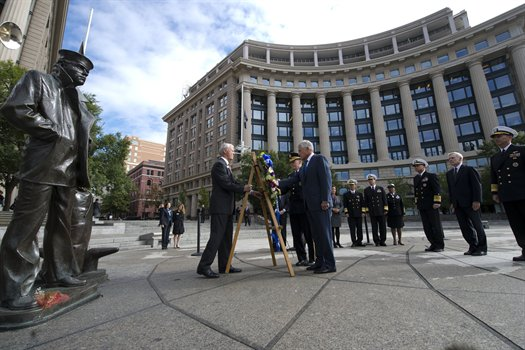 """Defense Secretary Chuck Hagel, center, and Army Gen. Martin E. Dempsey, chairman of the Joint Chiefs of Staff, lay a wreath at the Navy Memorial in D.C., September 17, 2013.   Navy Adm. James A. Winnefeld Jr., third from right, vice chairman of the Joint Chiefs of Staff, Navy Secretary Ray Mabus, second from right, and Navy Adm. Jonathan W. Greenert, right, chief of naval operations, look on. Hagel and Dempsey placed wreath next to """"The Lone Sailor,"""" a statue representing """"all people who have ever served, are serving now, or are yet to serve in the United States Naval services."""""""