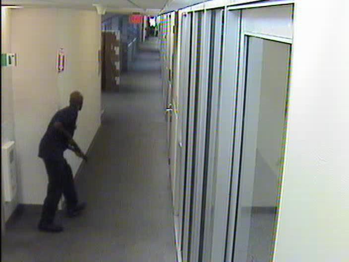 Aaron Alexis moves through the hallways of Building #197 carrying the Remington 870 shotgun on September 16, 2013.