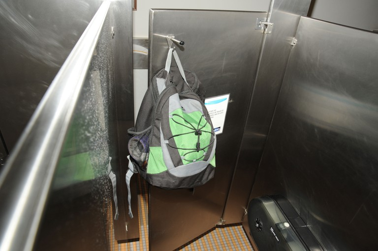 Aaron Alexis' backpack was found in the fourth-floor men's bathroom, hanging on the back of a stall door on September 16, 2013.