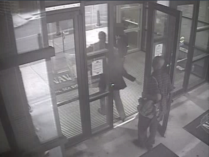 Aaron Alexis enters Building #197 at 8:08 a.m. on September 16, 2013, carrying a backpack. Alexis had legitimate access to the Washington Navy Yard as a result of his work as a contractor, and he utilized a valid pass to gain entry to the building.