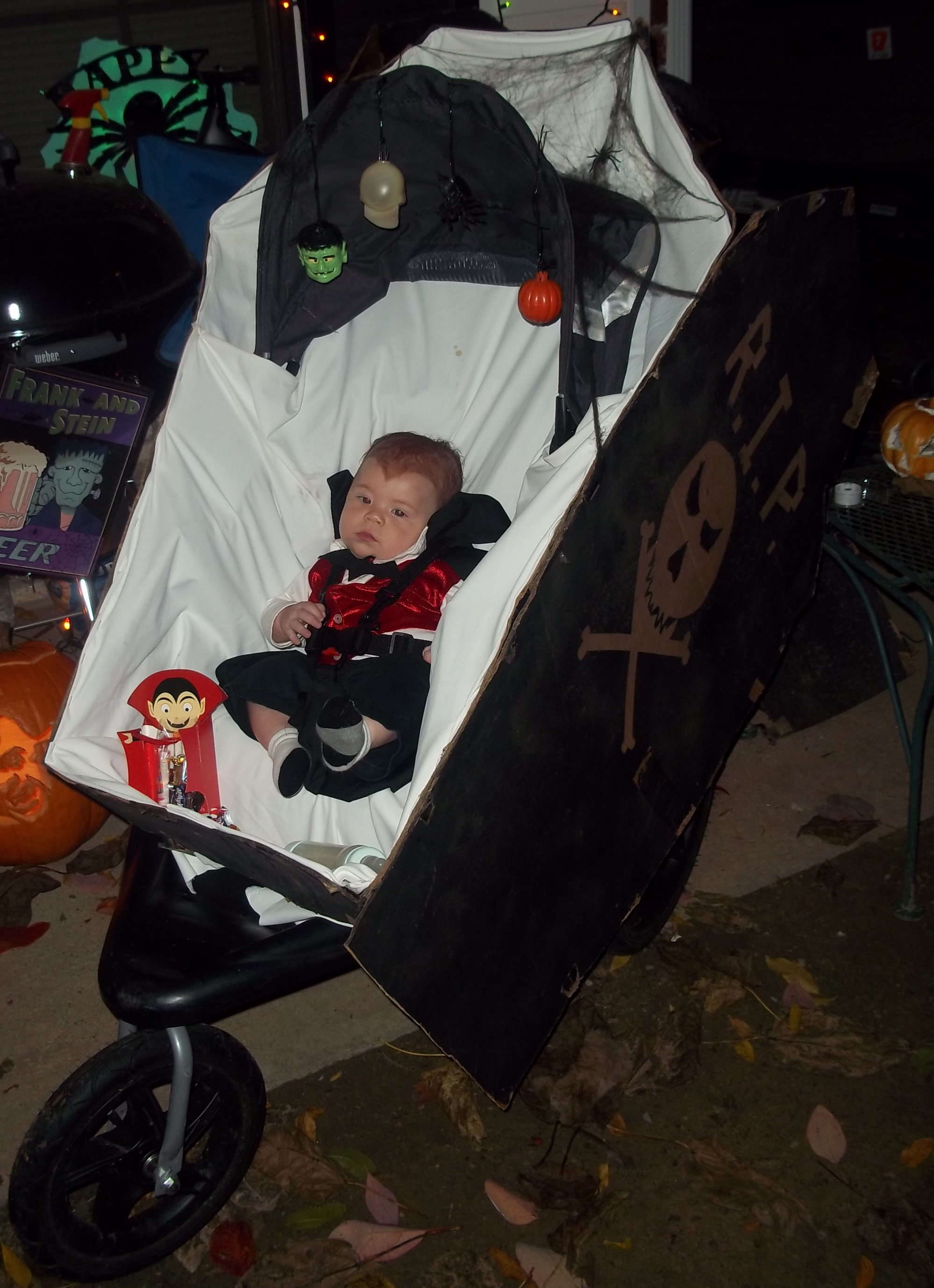 3 and 1/2 month old Baby Daniel was dressed as Dracula for his first Halloween. He was escorted around to trick or treat in his stroller coffin. Everything was homemade by momma Susie.