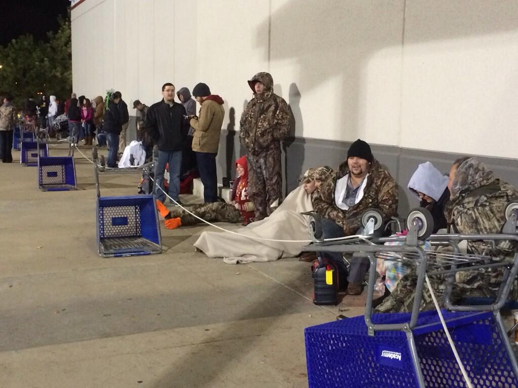 Campers wait outside Academy in Fort Smith