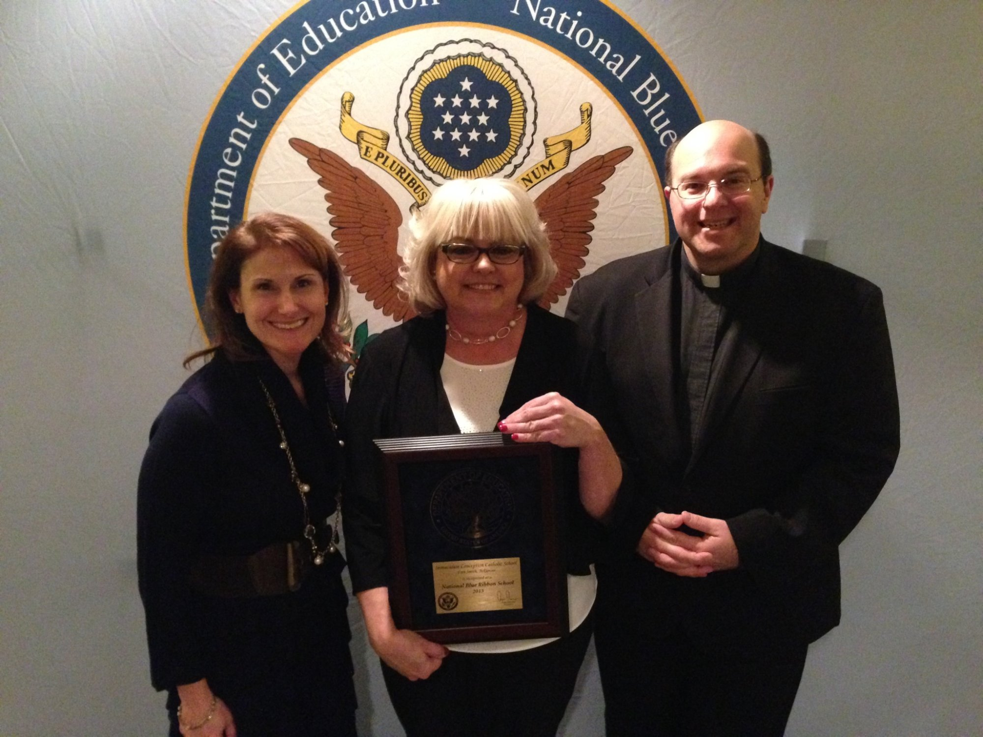I.C. School Officials picking up National Blue Ribbon School Award.