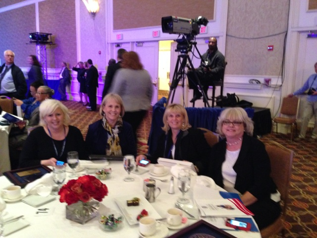 """Local school officials at """"Table 74"""" during the private ceremony."""