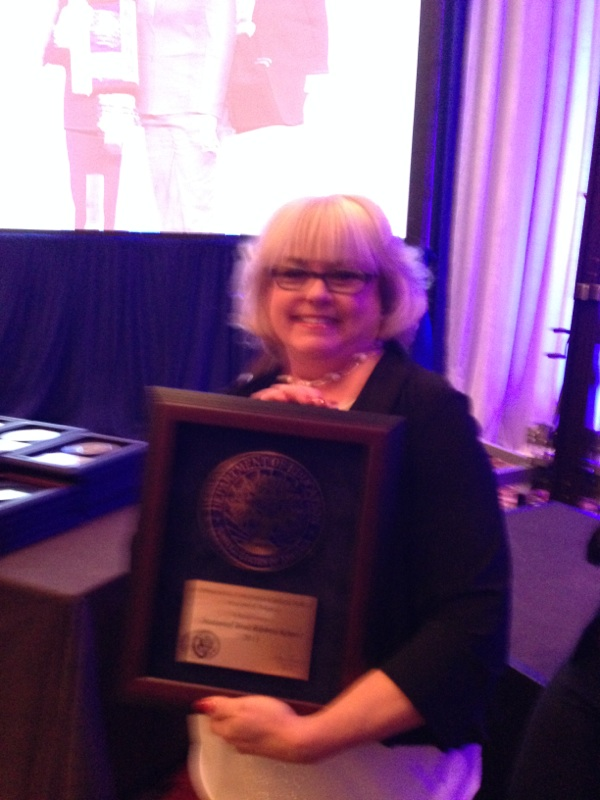 Sharon Blentlinger, Principal of I.C. with the award.