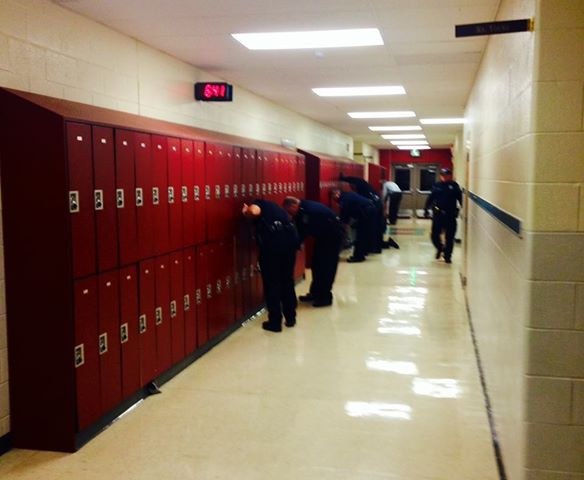 Police Search Lockers Roam School After Threats To Kill