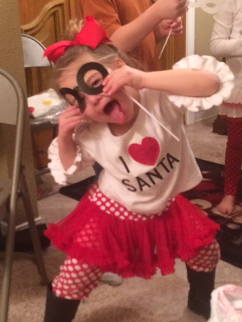 Granddaughter, Annalyse, being silly while waiting for Santa