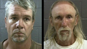 Smith and Guerra in booking photos from last year
