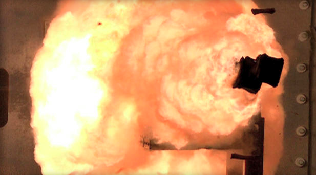 In this Feb. 24, 2012 photo provided by the U.S. Navy, a high-speed camera captures the first full-energy shots from an electromagnetic launcher at a test facility in Dahlgren, Va. (photo courtesy of CBS News).
