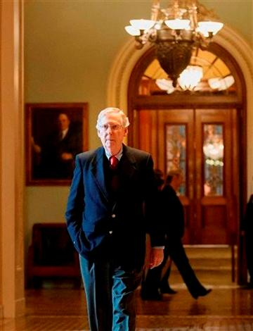 Senate Minority Leader Mitch McConnell of Ky. returns to his Capitol Hill office in Washington, Monday, Feb. 3, 2014, after speaking on the floor as the Farm Bill is considered. (Photo courtesy of KPHO.)