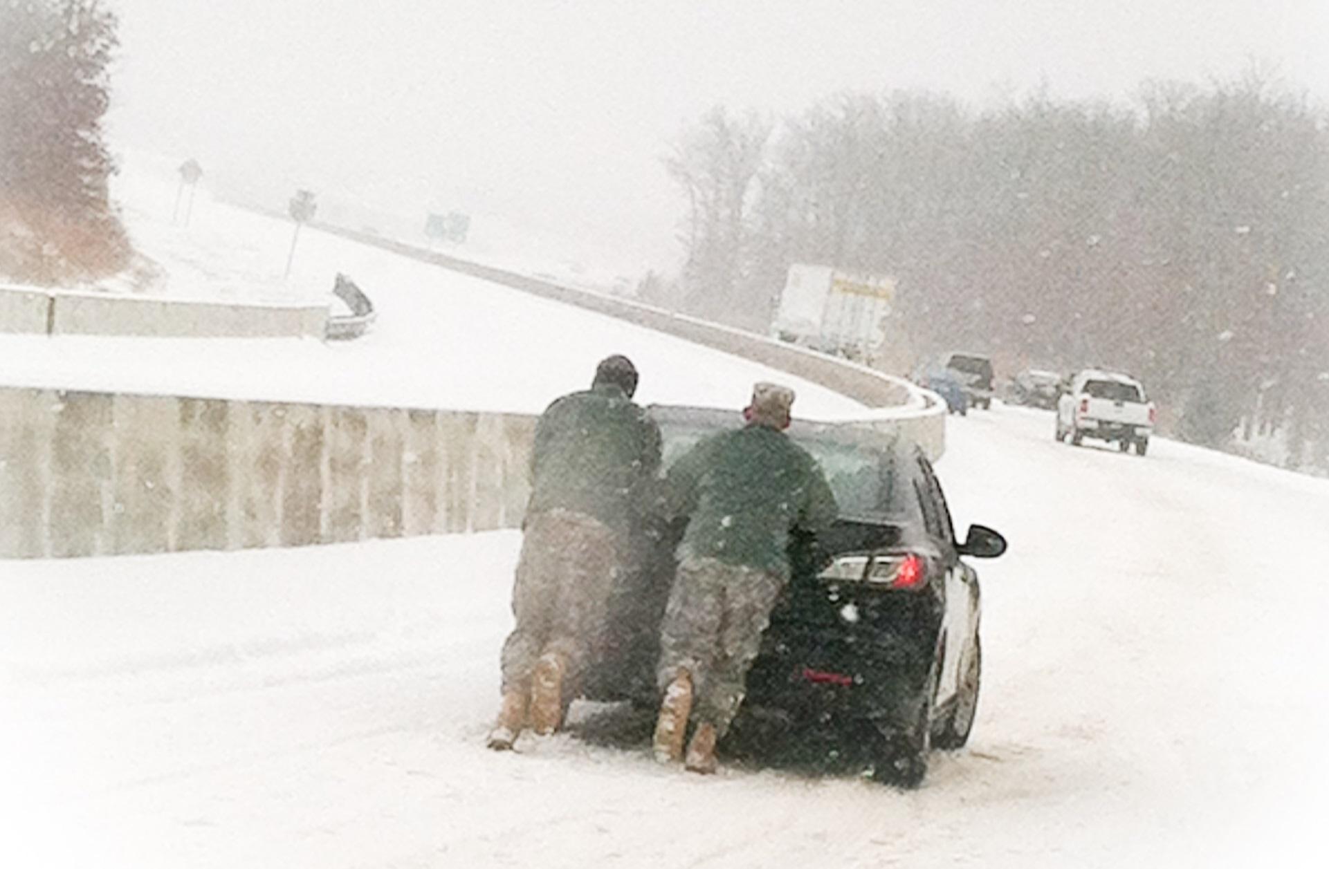 snow pushing car cropped