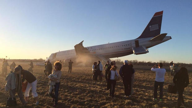 Passengers mill around and take pictures after being evacuated safely from US Airways Flight 1702. COURTESY OF WILL JAGER
